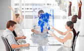 Cheerful business workers using blue map diagram interface — Stock Photo