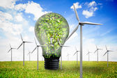Wind turbines and bulb full of leaves — Stock Photo