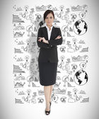 Young businesswoman with arms folded — Stock Photo