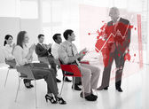 Business clapping stakeholder standing in front of red ma — Stock Photo
