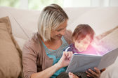 Mother reading storybook with son — Stock Photo