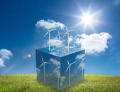 Wind turbines on cube showing more wind turbines — Stock Photo