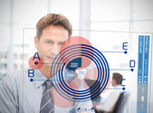 Businessman looking at blue diagram interface — Foto Stock