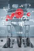 Confident mechanic standing under futuristic interface in black — Stock Photo
