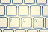 Blank keyboard with FAQ — Stock Photo