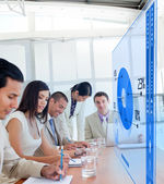 Group of colleagues using blue pie chart interface — Stock Photo