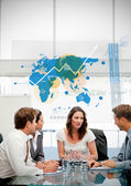 Business workers using blue map diagram interface — Stock Photo