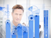 Businessman looking at blue futuristic diagram interface — Stock Photo