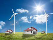 Houses in a turbine field — Stock Photo