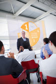 Business clapping stakeholder standing in front of yellow — Stock Photo