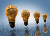 čtyři žárovky v řádku — Stock fotografie