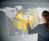 Well dressed business woman using yellow pie chart futuristic in — Stock Photo