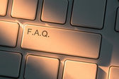 Keyboard with close up on Frequently Asked Question button — Stok fotoğraf