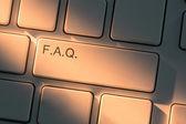 клавиатура с закрыть вверх на кнопке часто задаваемые вопросы — Стоковое фото