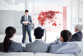 Business listening and looking at red map diagram interfa — Stock Photo
