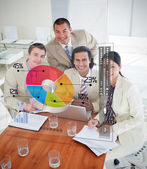 Overview of happy colleagues using colorful pie chart interface — Stock Photo