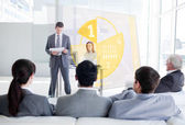 Business listening and looking at yellow pie chart interf — Stock Photo