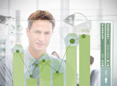 Businessman looking at green chart interface — Foto Stock