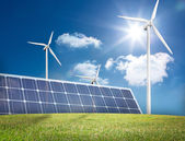 Large solar panel and three wind turbines — Stock Photo