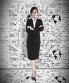Attractive businesswoman with arms folded — Stock Photo