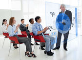 Business clapping stakeholder standing in front of blue p — Stock Photo