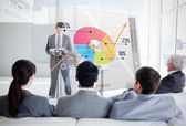Business listening and looking at colorful pie chart inte — Stock Photo