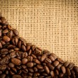 Coffee beans and burlap sack — Stock Photo #25720041