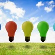 Five colored light bulb in the air — Stock Photo