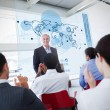 Business clapping stakeholder standing in front of map di — Stock Photo