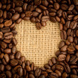 Heart indent in coffee beans — Stock Photo #25720573