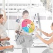 Cheerful business workers using colorful pie chart interface — Stock Photo #25720653
