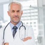 Doctor with stethoscope around his neck — Stock Photo #25722893