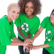 Three enviromental activists putting their hands together and smiling — Stock Photo