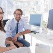 Designers sitting at their desk and smiling — Stock Photo #25723255