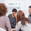 Stock Photo: Patient crying during a group session