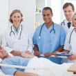Medical team and patient smiling — Stock Photo