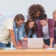 Stock Photo: Creative team looking at laptop