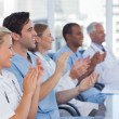 Medical team clapping their hands — Stock Photo