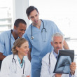 Stock Photo: Medical team examining radiography