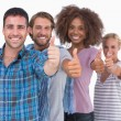 Happy stylish group giving thumbs up — Stock Photo
