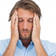 Man touching his temples to calm a headache — Stock Photo