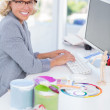 Smiling interior designer working on her computer — Stock Photo