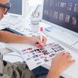 Stock Photo: Photo editor marking contact sheet