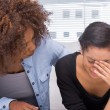 Sad woman crying next to her therapist — Stock Photo #25724437