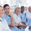 Medical team sitting in row — Stock Photo