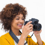Happy girl taking a photo — Stock Photo