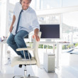 Man surfing his office chair — Stock Photo