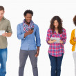 Stock Photo: Fashionable friends standing in row using medidevices