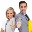 Architects with plans and hard hat showing thumbs up — Stock Photo #25725387