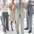 Group of business giving thumbs up — Stock Photo